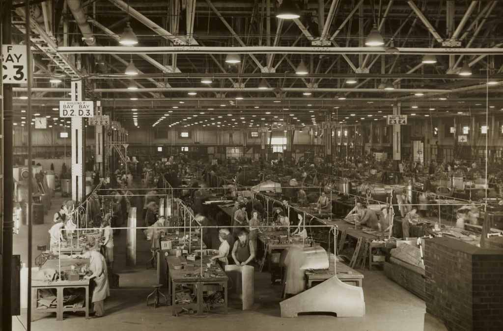Fig.4: The Modern Assembly Line guaranteed high performance through engineered tasks. Here a Spitfire Factory during World War II. Photo by Birmingham Museums Trust on Unsplash