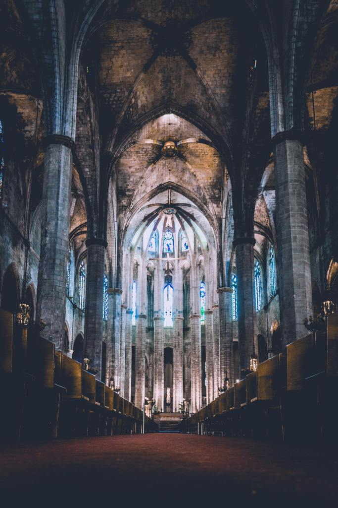 Fig.3: The Basilica del Mar in Barcelona. Gothic Cathedrals are a symbol of a new way of organising work, as their construction spanned several decades. But also of the way people approached Work. Photo by Derek Story on Unsplash