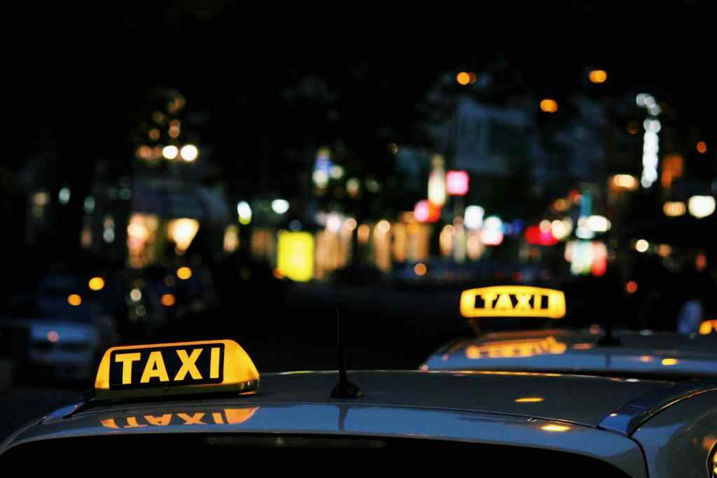 Fig.2: Taxis in Budapest, Hungary. The Taxi Driver profession is an area where the Discourse of Work as Craftsmanship still holds true. Photo by Lexi Ruskell on Unsplash