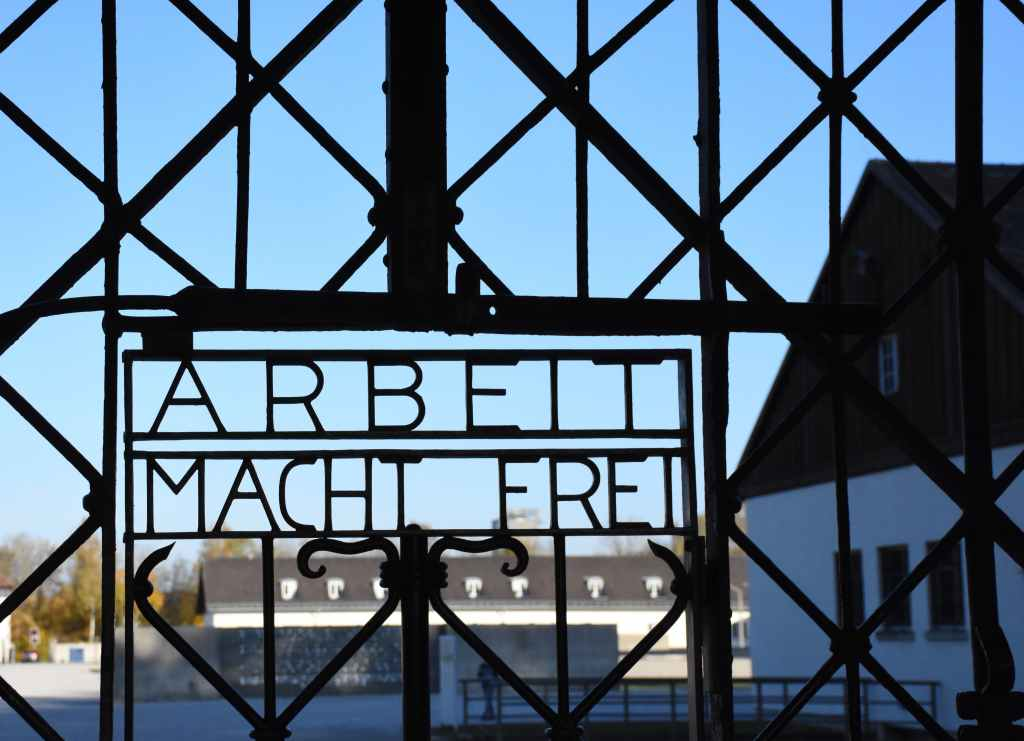 "Fog.4: Job becomes an ethical construct in modern societies. The most illustrative expression of this being the ""Arbeit Macht Frei"" writing on the gates of Nazi's German Concentration Camps. Here the one of Dachau, Germany. Photo by Nancy Hann on Unsplash"