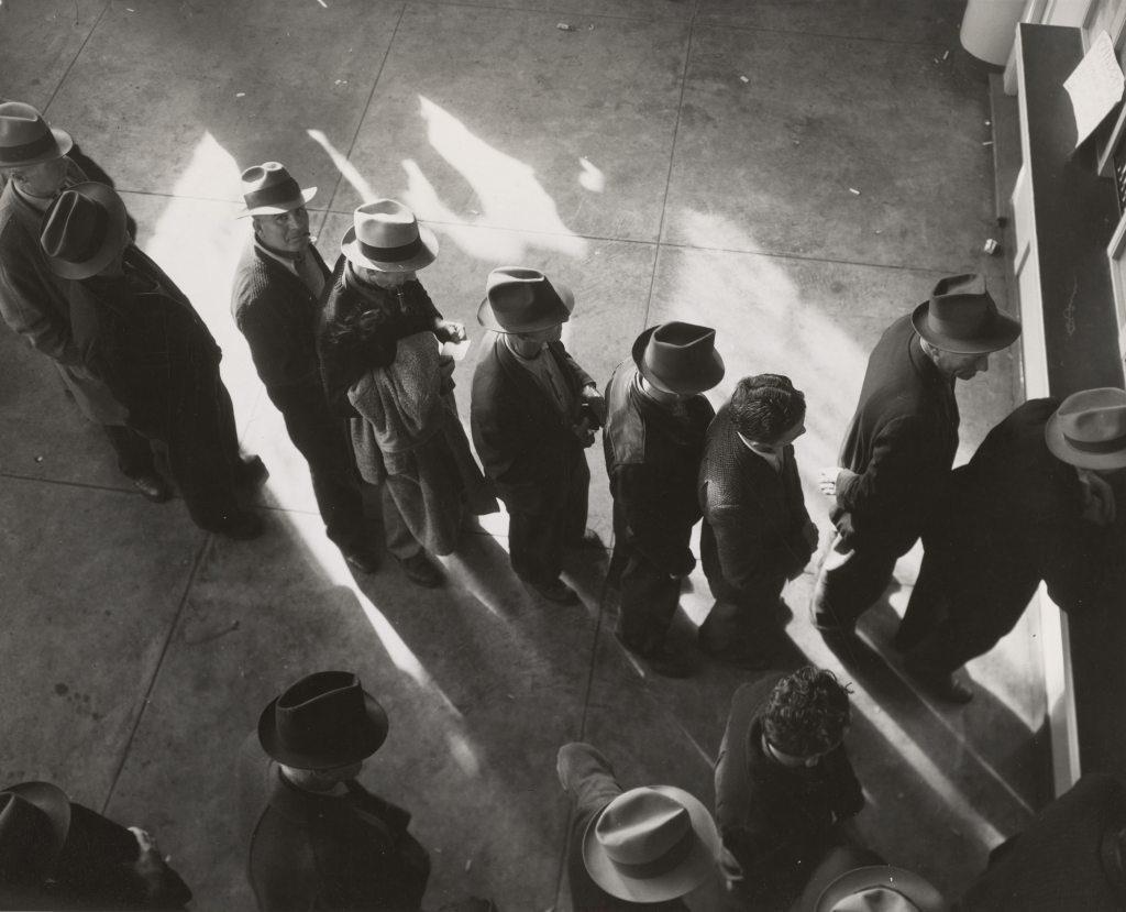 Fig.2: People queuing for unemployment benefits, 1938. Also unemployment is a construct of this new Discourse of Work. Photo by The New York Public Library on Unsplash